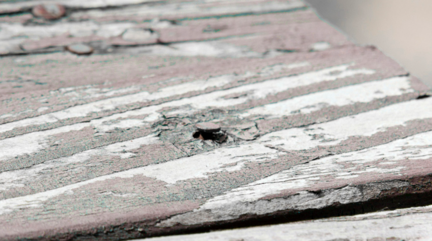 Damaged Deck Boards with Raised Nail